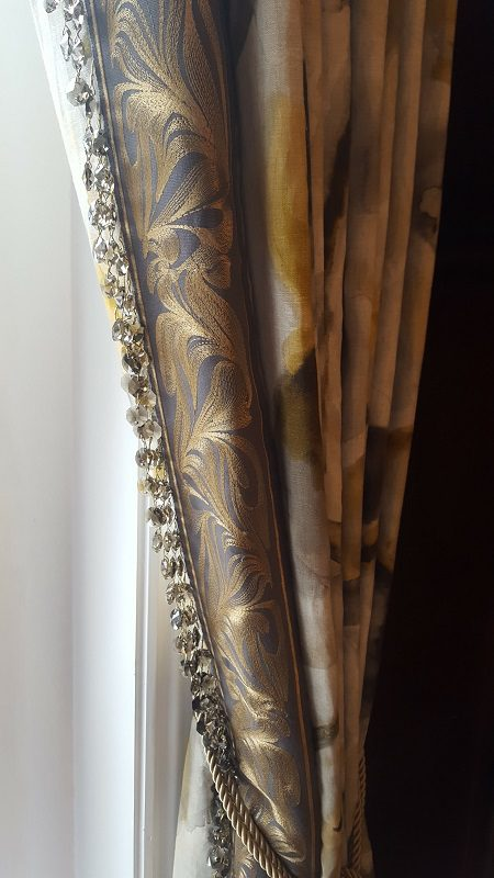 Curtain with bead and border edging