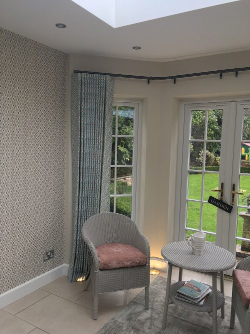 Full length curtains in a bay window