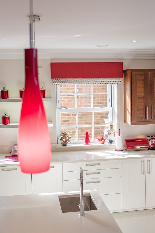 Kitchen setting with pelmets and roman blinds at windows
