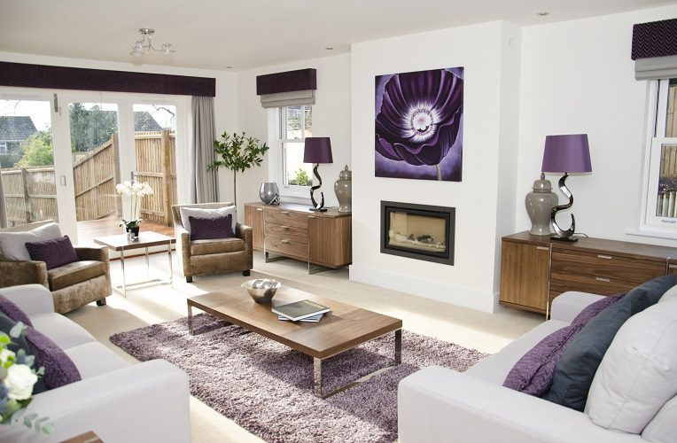 Silver curtains and roman blinds under purple pelmets