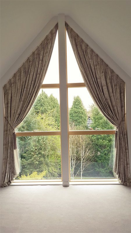 Trapezoid curtains for a tall window