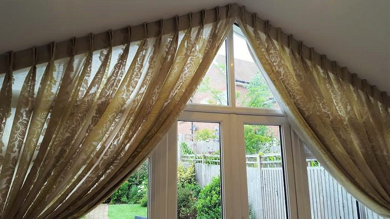 Trapezoid curtains on a wide window